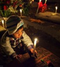 Xoxocotlan_Cemetery_mexico_boy_with_candle